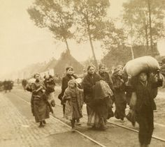 Homeless World War I refugees carry their meager belongings.