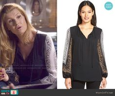Rayna's black blouse with printed sleeves on Nashville.  Outfit Details: http://wornontv.net/53150/ #Nashville