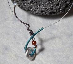 """""""Fusillo2"""" Girocollo in Argento e Titanio con perla e corniola / Silver and Titanium necklace with Pearl and Carnelian stone  http://titonegri.it/sito/?page_id=565#!/Titania/c/3288061/offset=0&sort=normal #girocollo #gioielli #argento #artigianato #nacklace #silver #luxury #jewels #jewellery #handmade"""