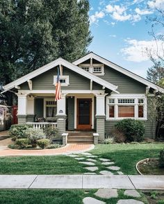 Craftsman style can be achieved with Craftsman exterior colors like green, blue, cream, and even navy and black. Craftsman Front Porches, Craftsman Bungalow Exterior, Craftsman Style Interiors, Modern Farmhouse Exterior, Craftsman Style House Plans, House Paint Exterior, Craftsman Bungalows, Exterior House Colors, Exterior Design