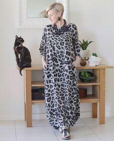 Deborah wears an animal print maxi dress   40plusstyle.com