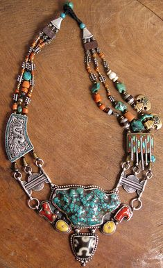 Nepal |  Tibetan style necklace made from silver with amber, Agate, coral and turquoise