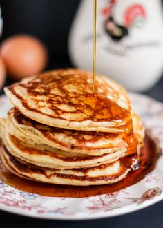 Delicious gluten free banana pancakes made with wholesome ingredients like quiona flour and greek yogurt. Over 10g of protein!