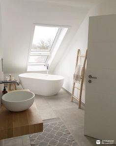 We love Mia's bathtub with a view! What a beautiful white bathroom.