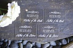 Clear acrylic reserved signs for parents of the bride and groom. Custom designed and hand painted.