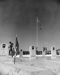 """Marine Division cemetery, Iwo Jima, 1945 Photo caption: Iwo Jima, March The """"Fighting Fourth"""" Marine Division raise the Stars and Stripes over the graves of its slain, buried in the Division's cemetery. Battle Of Iwo Jima, Military Cemetery, Us Marines, Photo Caption, National Archives, Marine Corps, Military History, Usmc, World War Two"""