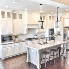 Favorite kitchen look, simple clean cavinets, solid grey counter, glass top cabinets