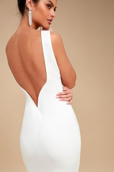 Lulus Exclusive! When you slip into the So Stunning White Backless Midi Dress you will be just that, so stunning! Figure-flaunting stretch knit frames your curves from a high, rounded neckline and sleeveless, darted bodice, down to a midi-length hem. An ultra-deep V-back (with hidden V-bar for added support) dips low to show off your sexy side. Kick pleat at back.