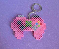 Pink x-box controller perler beads.