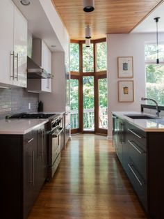 Opening up the space and putting a wood ceiling!  Gorgeous-Galley-Kitchen
