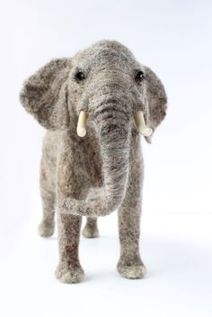 Holy crap! Yarn and stuff! • sosuperawesome:   Needle felted animals by...