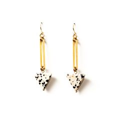 These gorgeous earrings feature dalmation jasper triangles dangling from vintage skinny brass rectangles. These pieces feature gold plated nickel free posts. By Michelle Starbuck Jewelry