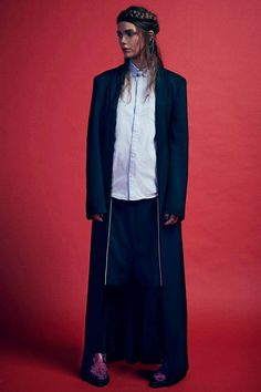 Viktorya | Positive Magazine | Overcoat, Shorts and Leggings by Stefano Lo Muzio FW13.  Stylist: Giulia Meterangelis Photographer: Massimo Pisati Hair&Make-Up: Carolina Albertini Model: Viktorya ICEMODELS MILAN
