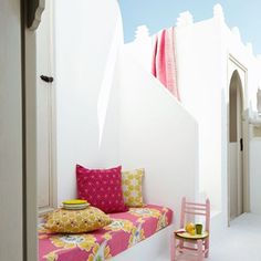 Pair brightly coloured fabrics against a crisp white background. A children's chair makes for a quirky tiny table