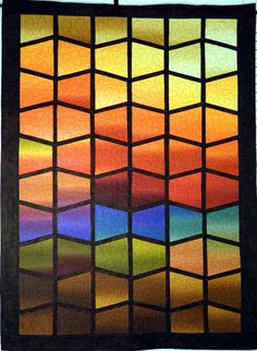 Stain glass style quilted wall hanging by Quiltsbysuewaldrep, $130.00