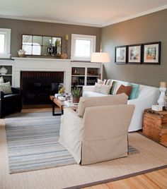 {pretty much a replica of our living room architecture}  wall color: Benjamin Moore Copley Grey...just noticed she also painted the entire inside of her bookshelves, too!