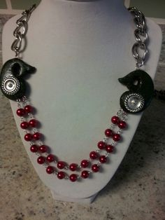 Polymer clay mango focal beads used with red perls in a necklace by Bhavna Mistry