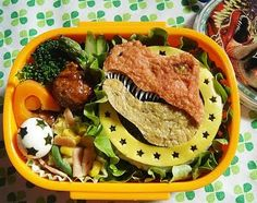 Dinosaur bento!  This page has some other WOW bentos too.