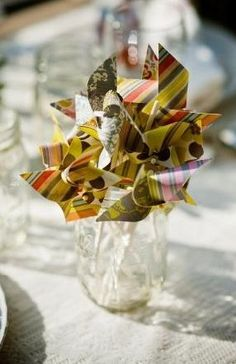 I remember making these little windmill things...would be cute wedding favours
