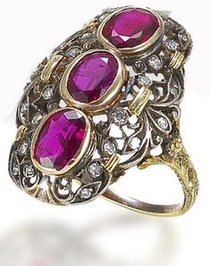 A ruby and diamond ring, by Buccellati, circa 1920.   The delicately pierced foliate plaque of gold and silver with three collet-set oval-shaped rubies and single-cut diamond highlights, unsigned, ring size L½, fitted maker's case. Bonhams.