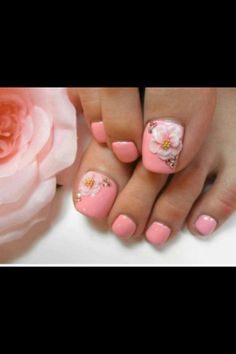 I love love this pink floral pedicure nail design! How cool would it be for a bridal party to all have this look . Pretty color!