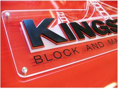 Dimensional letters on clear backer with vinyl graphics & decorative standoffs