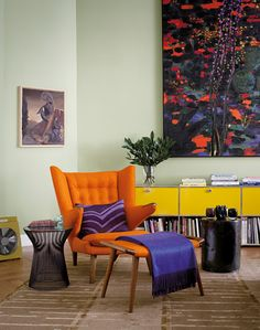 Subtil mélange de styles à Berlin - the orange armchair is fantastic!  With the purple accent.  My fav colors together!