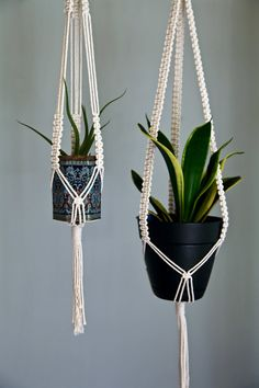 This classic macrame plant hanger is handmade with 3mm natural white cotton rope, has three fully knotted strands, and is hung by a small brass