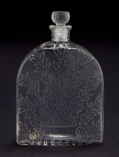 R. LALIQUE CLEAR AND FROSTED GLASS LAVANDE ALPY PERFUME BOTTLE . Circa 1929.