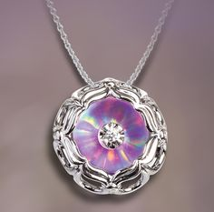 Illusia diamond pendant with unseen lavender lab-grown opal beneath the diamond, creating a splash of color throughout the 14k white gold setting. Style A6.