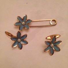 A personal favorite from my Etsy shop https://www.etsy.com/listing/260343292/flower-brooch-cuff-links-set-vintage