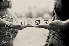 Fun with kid alphabet blocks during the maternity shoot