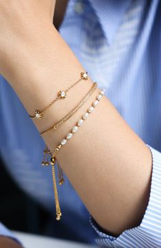 Yellow gold bracelet stack featuring mother of pearl, white sapphires and pearls.