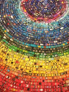 UK-based artist David T. Waller used 2,500 toy cars to create this beautiful and colorful installation piece titled Car Atlas.