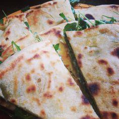 Torta al testo filled with stracchino and arugula