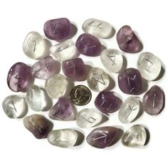 Amethyst and clear quartz rune sets. I know right now I'm obsessed with them.