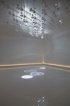 This installation by Hackney studio Troika creates overlapping pools of light on the floor like raindrops falling on water.