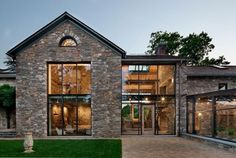 country home with antique stone walls and large windows