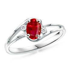 Oval Ruby and Diamond Split Shank Ring