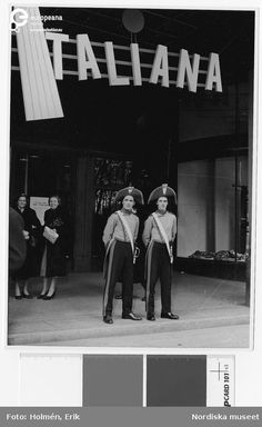 """Italiana"", fashion show at Nordiska Kompaniet, 1953. Two guards waiting at the gate, photo by Erik Holmén. Courtesy Nordiska Museet, CC BY NC ND."