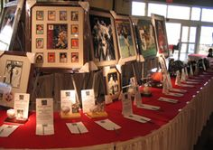 Great Silent Auction display - Good spacing between bid sheets, items up high for best visibility with details listed on tent cards right near bid sheet, and the table layout has curved arc to the next section for better traffic flow.