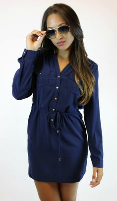 Lightweight long sleeve tunic in navy blue makes for a perfect fall ensemble with the option to convert to ¾ sleeve. $39