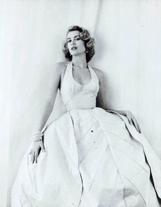 Grace Kelly in the Oleg Cassini flower petal dress from a Milton Greene photo shoot for Look magazine.