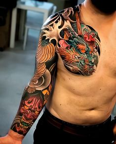 Japanese tattoo sleeve by Swipe to the side to see both photos! Japanese Tattoo Sleeve Samurai, Samurai Mask Tattoo, Japanese Tattoos For Men, Japanese Dragon Tattoos, Japanese Tattoo Art, Traditional Japanese Tattoos, Japanese Tattoo Symbols, Oni Mask Tattoo, Armor Tattoo