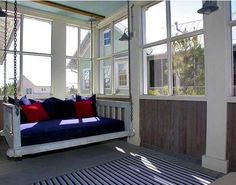 screened-in porch with swinging daybed = bliss