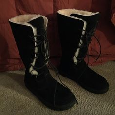 NEW UGGS Black tall NWOT These UGGS have never seen the outside. Only tried on. Black lace up. NWOT Not one flaw! Authentic! Cardboard still in toes. Price is firm. UGG Shoes Winter & Rain Boots