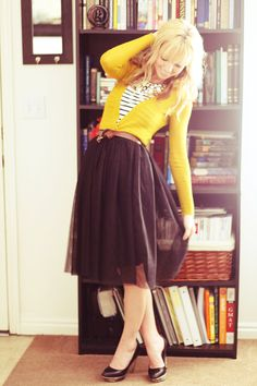 yellow cardigan paired with stripes, a black twirly skirt, and pumps? Yes, please.