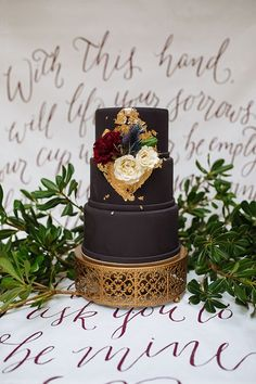 Black wedding cake with gold foiling | Photo by Smith House Photography
