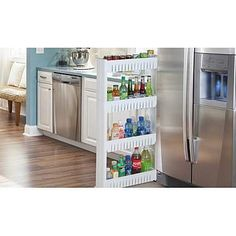 Store Kitchen Products, Food, Cleaning Supplies and More Also Ideal for Bathroom, Laundry Room, Garage and More. Create loads of additional storage in an area with limited space.Slim Pull-out tier Cupboard on Wheels, Casters makes it Glide Effortlessly for Easy Access Keeps items organized & Easy to wash.Fits Perfectly Between Fridge and Counter or In-between Your Washer and Dryer.Measures: 54''H x 21.5''W x5.25''D. Easy assembly requiredA must have for every home!