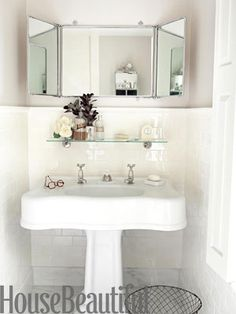 1928 cast-iron pedestal lavatory -- 1920s French trifold mirror -- Waterworks Easton hot and cold faucets -- Waterworks Vintage Collection subway tile -- tile wainscoting is 50 inches high -- designed by Barbara Sallick